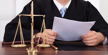 Разбирательство через суд